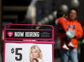 A 'now hiring' sign is posted in front of a clothing store on September 27 2012 in San Francisco California The Labor Department reported that new...