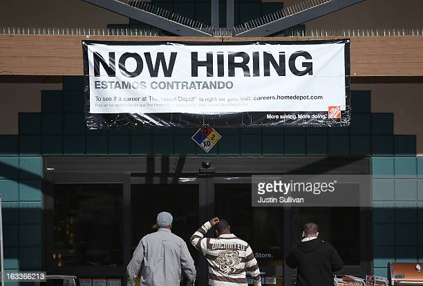 A 'Now Hiring' sign is posted in front of a Home Depot store on March 8 2013 in San Rafael California The Labor Department reported today that 236000...
