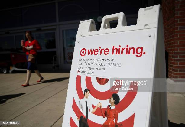 A now hiring sign is posted in front of a Target store on September 25 2017 in San Rafael California Target Corp annouced plans to raise the hourly...