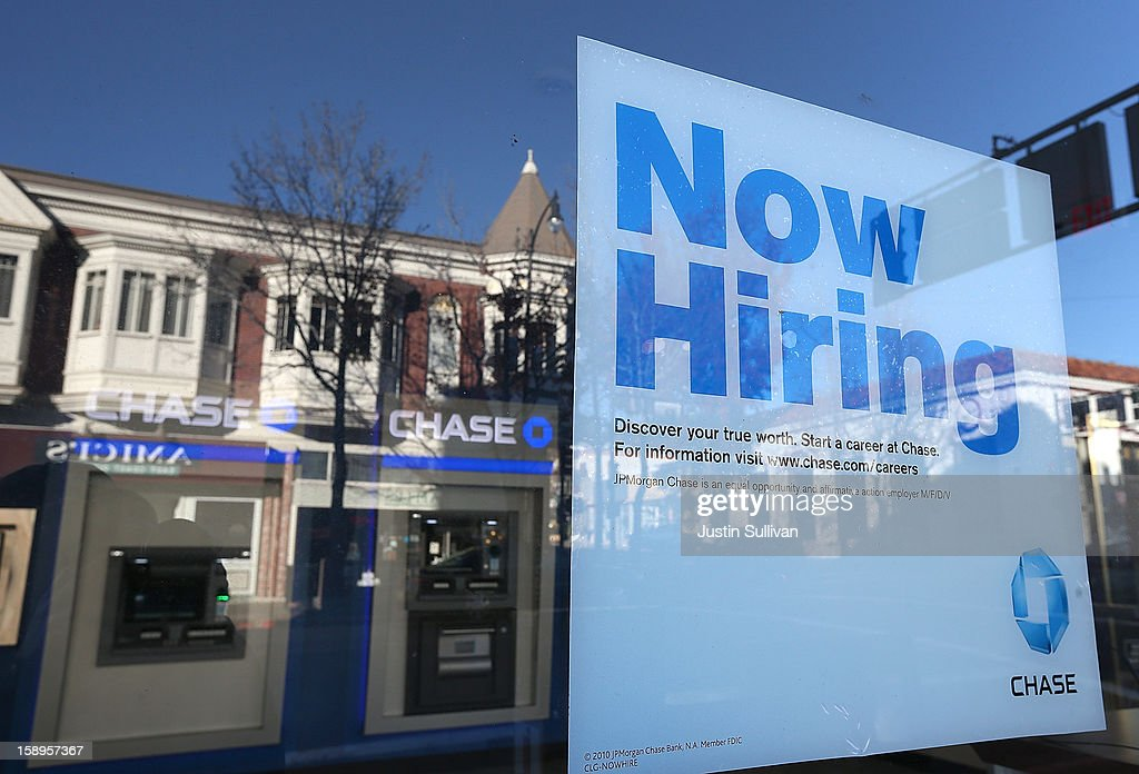 A 'now hiring' sign is posted in the window of a Chase bank branch on January 4, 2013 in San Rafael, California. According to a Labor Department December jobs report, the U.S. unemployment remained the same from November at 7.8% as employers added 155,000 jobs in December.
