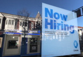 A 'now hiring' sign is posted in the window of a Chase bank branch on January 4 2013 in San Rafael California According to a Labor Department...