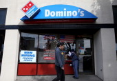 A 'Now Hiring' sign is posted in the window of a Domino's Pizza restaurant on March 8 2013 in Albany California The Labor Department reported today...