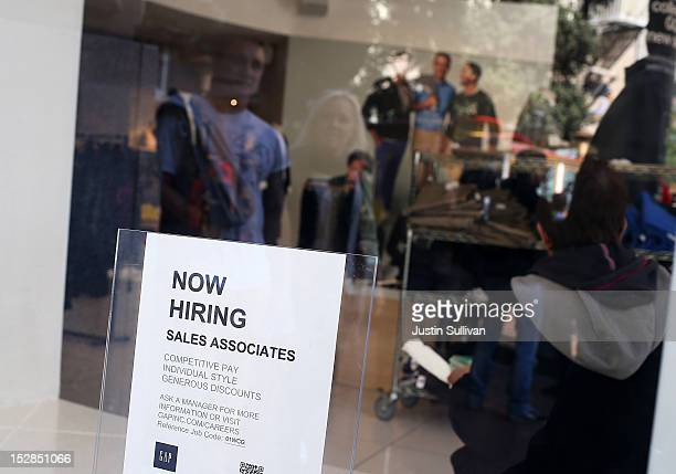A 'now hiring' sign is posted in the window of a GAP store on September 27 2012 in San Francisco California The Labor Department reported that new...