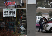 A now hiring sign is posted in window of an O' Reilly auto parts store on November 7 2014 in San Rafael California According to a US labor department...