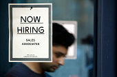 A 'now hiring' sign is posted on an Urban Outfitters Inc store in San Francisco California US on Friday Aug 15 2014 Urban Outfitters Inc is scheduled...
