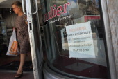 A ''Now Hiring'' sign is seen in the store front window on July 5 2012 in Miami Beach Florida The ADP released the National Employment Report which...