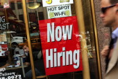 A 'now hiring' sign is viewed in the window of a fast food restaurant on August 7 2012 in New York City In a further sign that the American economy...