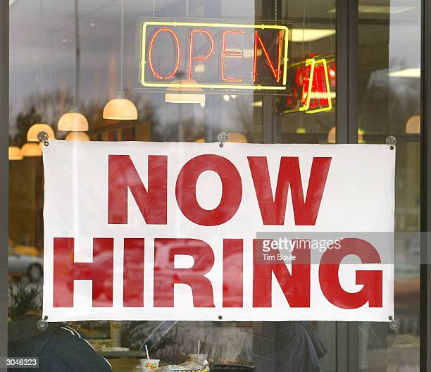 'Now Hiring' signage is visible in the window of a Subway restaurant March 5 2004 in Des Plaines Illinois The Labor Department today reported the US...