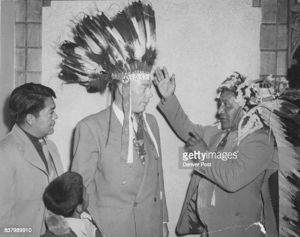 Now It's 'White Eagle' Eddie Box and his son Eddie Jr look on as Julius Cloud presents a war bonnet to Robert W Fenwick Denver Post reporter and...