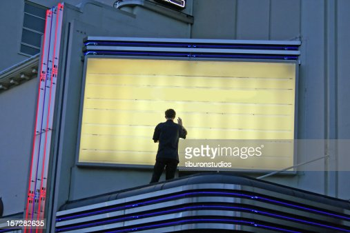 Now Showing! Man Changing Sign