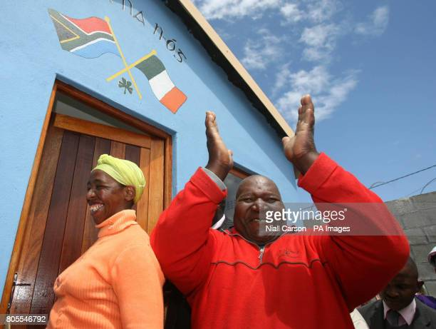 Nowthu and Mjangaza Sgentsu celebrate after receiving the keys to their first home in Wallacedene Township in Capetown after living in a shack for 11...