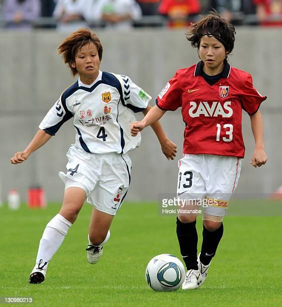 Nozomi Fujita of Urawa Red Diamonds Ladies and Asuna Tanaka of INAC Kobe Leonessa compete for the ball during the Nadeshiko League match between...
