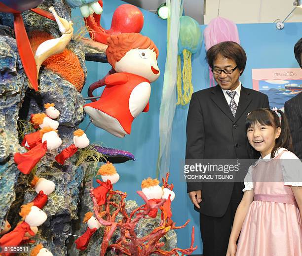 Nozomi Ohashi eightyearold singer of the theme song of the animation movie 'Ponyo on the Cliff by the Sea' gazes at a clay model of the fishgirl...