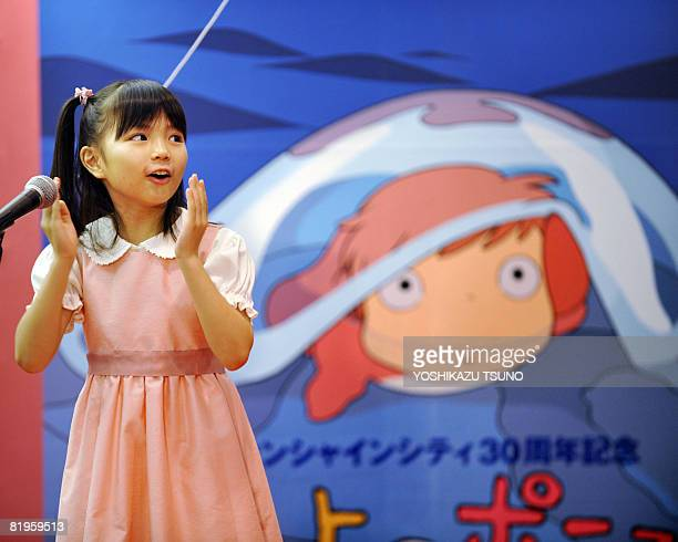 Nozomi Ohashi eightyearold singer of the theme song of the animation movie 'Ponyo on the Cliff by the Sea' sings at an exhibition of the movie in...