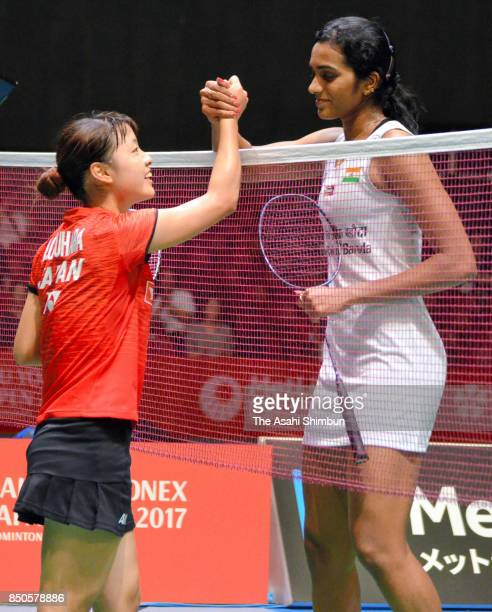 Nozomi Okuhara of Japan and Pusarla V Sindhu of India shake hands after the Women's Singles second round match during day three of the Daihatsu Yonex...
