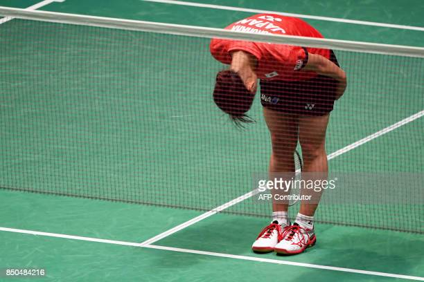 Nozomi Okuhara of Japan bows to her supporters after victory against Pusarla V Sindhu of India during their women's singles second round match at the...