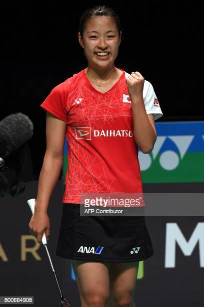 Nozomi Okuhara of Japan celebrates after defeating compatriot Akane Yamaguchi in the Australian Open women's singles badminton final in Sydney on...