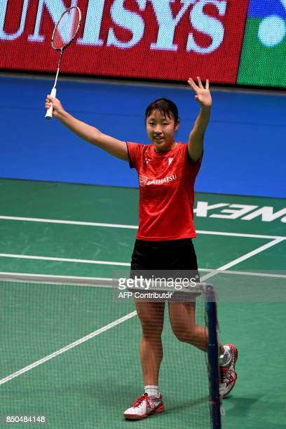 Nozomi Okuhara of Japan celebrates her victory against Pusarla V Sindhu of India during their women's singles second round match at the Japan Open...