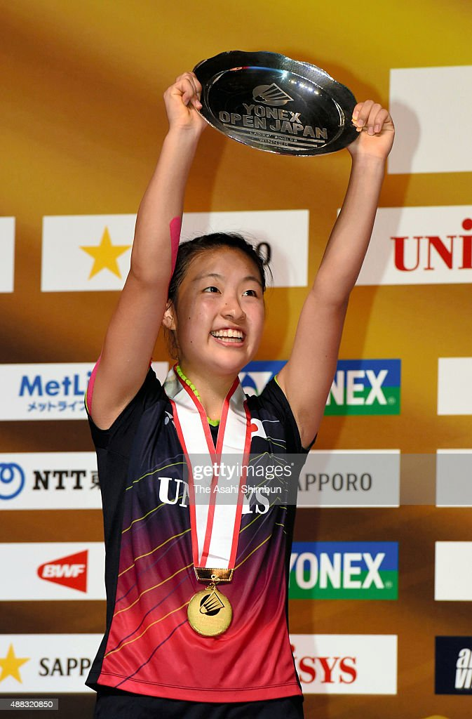 <a gi-track='captionPersonalityLinkClicked' href=/galleries/search?phrase=Nozomi+Okuhara&family=editorial&specificpeople=8294661 ng-click='$event.stopPropagation()'>Nozomi Okuhara</a> of Japan celebrates with the trophy on the podium after winning the Women's Final against Akane Yamaguchi during day six of the Yonex Open at Tokyo Metropolitan Gymnasium on September 13, 2015 in Tokyo, Japan.