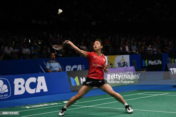 Nozomi Okuhara of Japan competes against Akane Yamaguchi of Japan during Womens Single Round 2 match of the BCA Indonesia Open 2017 at Plenary Hall...