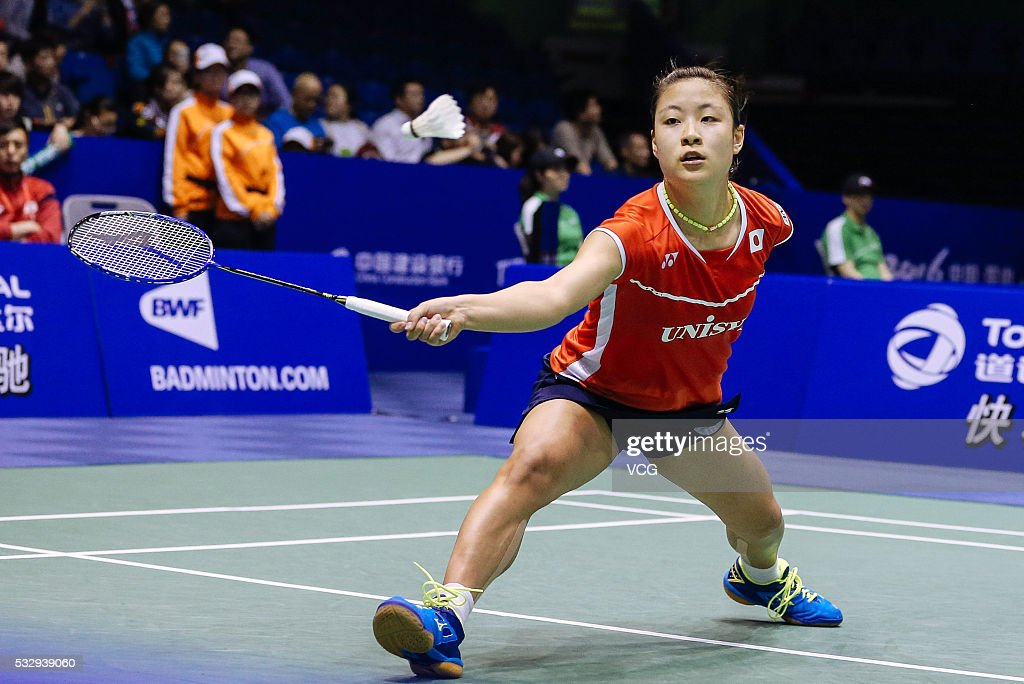 <a gi-track='captionPersonalityLinkClicked' href=/galleries/search?phrase=Nozomi+Okuhara&family=editorial&specificpeople=8294661 ng-click='$event.stopPropagation()'>Nozomi Okuhara</a> of Japan competes during the women's singles match against Line Kjaersfeldt of Denmark in the Uber Cup quarter final match on day five of Thomas & Uber Cup 2016 at Kunshan Sport Center on May 19, 2016 in Kunshan, Jiangsu Province of China.