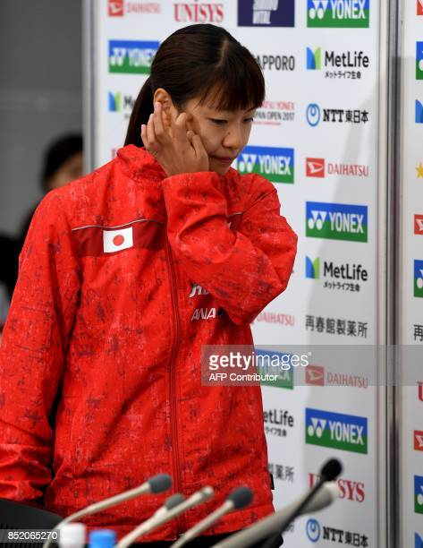 Nozomi Okuhara of Japan enters the room to hold a press conferene after she decided to withdraw from the women's singles semifinal match against...