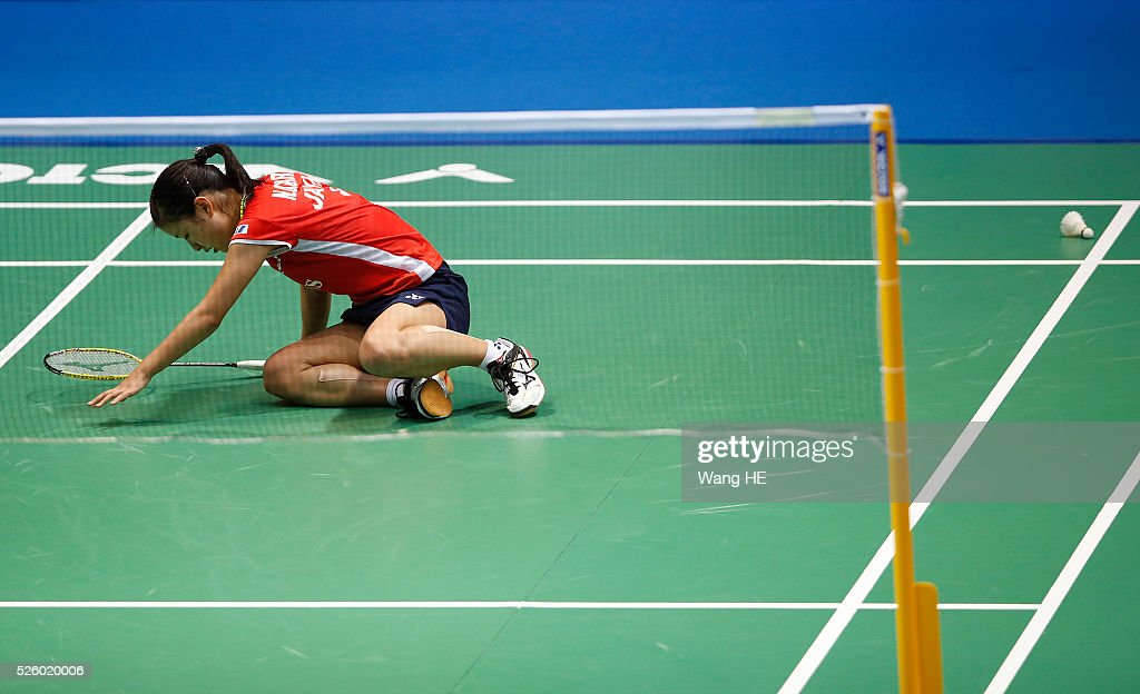 Nozomi Okuhara of Japan falls as she play against Wang Yihan of China Women's singles match at the 2016 Badminton Asia Championships, on April 29, 2016 in Wuhan, Hubei province, China.