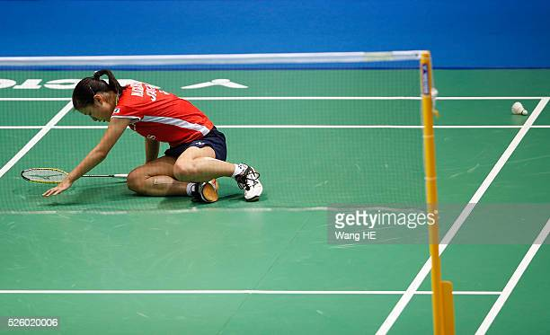 Nozomi Okuhara of Japan falls as she play against Wang Yihan of China Women's singles match at the 2016 Badminton Asia Championships on April 29 2016...
