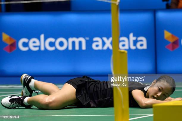 Nozomi Okuhara of Japan falls in her match against Carolina Marin of Spain during the women's singles semi final of the 2017 World BWF Super Series...