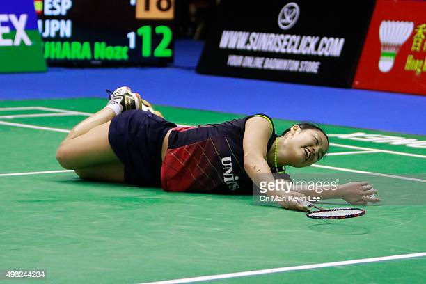 Nozomi Okuhara of Japan falls on the court during the match between Nozomi Okuhara of Japan and Carolina Marin of Spain at the final round of Women's...
