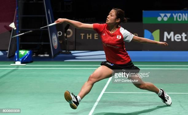 Nozomi Okuhara of Japan hits a return against compatriot Akane Yamaguchi in the Australian Open women's singles badminton final in Sydney on June 25...