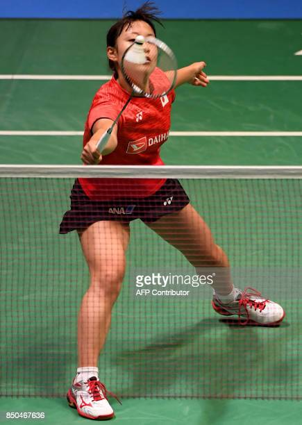 Nozomi Okuhara of Japan hits a return against Pusarla V Sindhu of India during their women's singles second round match at the Japan Open Badminton...