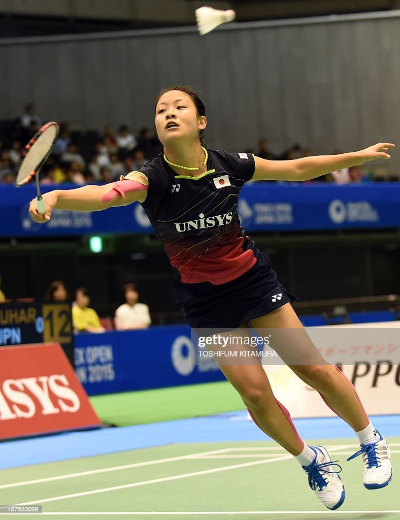 Nozomi Okuhara of Japan hits a return against Ratchanok Intanon of