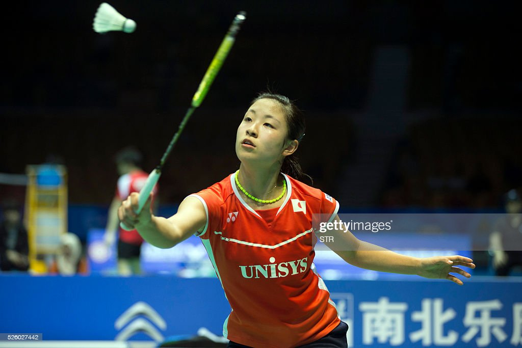 Nozomi Okuhara of Japan hits a return against Wang Yihan of China during their women's singles quarter-final match at the 2016 Badminton Asia Championships in Wuhan, central China's Hubei province on April 29, 2016. / AFP / STR
