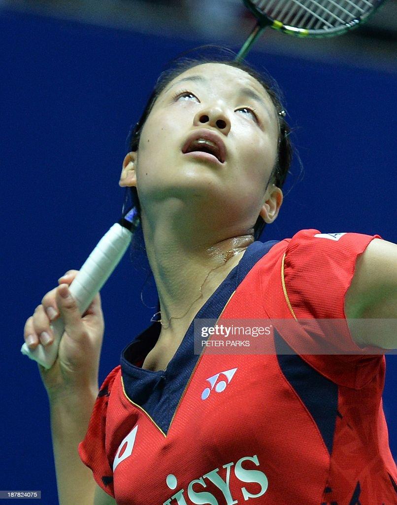 Nozomi Okuhara of Japan hits a return to Saina Nehwal of India in