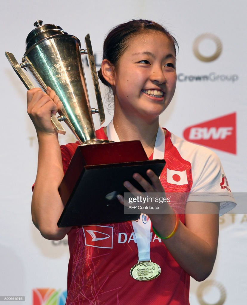 Nozomi Okuhara of Japan holds the winner s trophy after defeating
