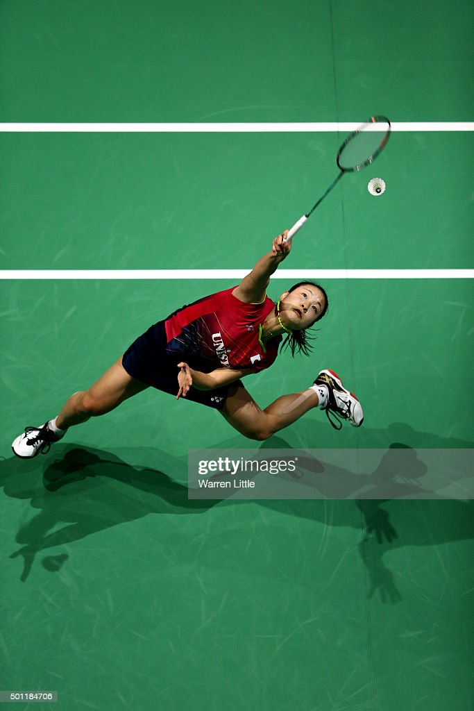 <a gi-track='captionPersonalityLinkClicked' href=/galleries/search?phrase=Nozomi+Okuhara&family=editorial&specificpeople=8294661 ng-click='$event.stopPropagation()'>Nozomi Okuhara</a> of Japan in actin against Yihan Wang of China during the Women's Singles Final match on day five of the BWF Dubai World Superseries 2015 Finals at the Hamdan Sports Complex on December 13, 2015 in Dubai, United Arab Emirates.