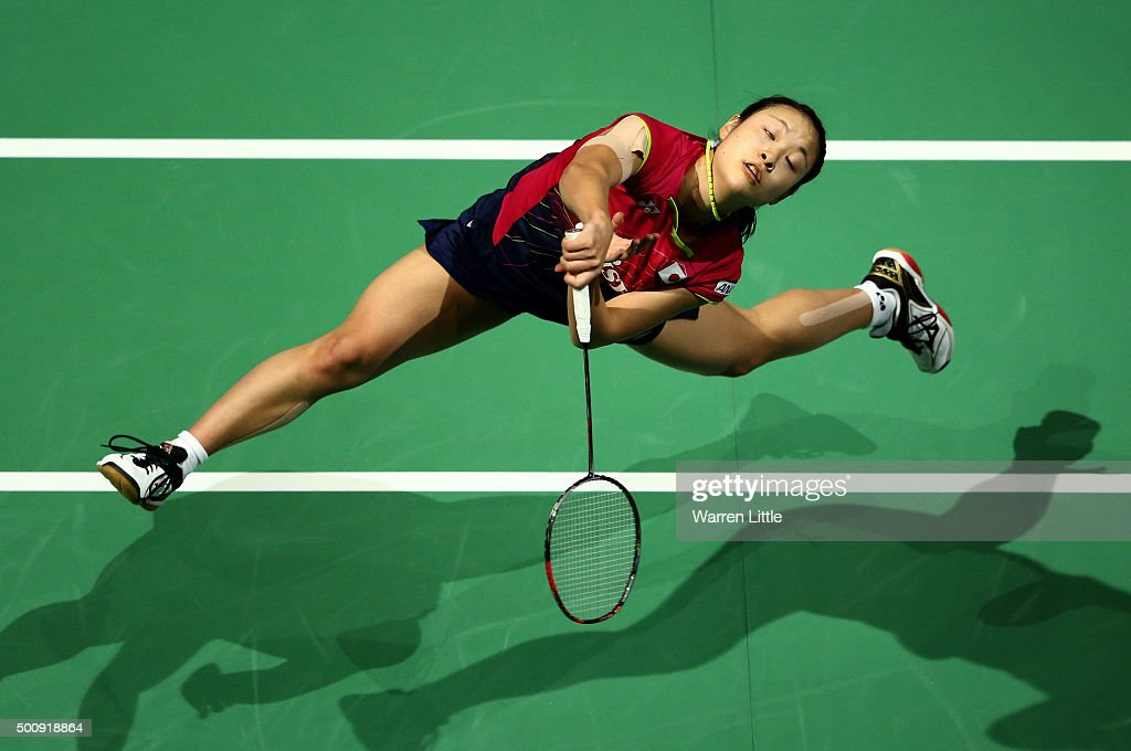 <a gi-track='captionPersonalityLinkClicked' href=/galleries/search?phrase=Nozomi+Okuhara&family=editorial&specificpeople=8294661 ng-click='$event.stopPropagation()'>Nozomi Okuhara</a> of Japan in action against Carolina Marin of Spain in the Women's Singles match during day three of the BWF Dubai World Superseries 2015 Finals at the Hamdan Sports Complex on December 11, 2015 in Dubai, United Arab Emirates.
