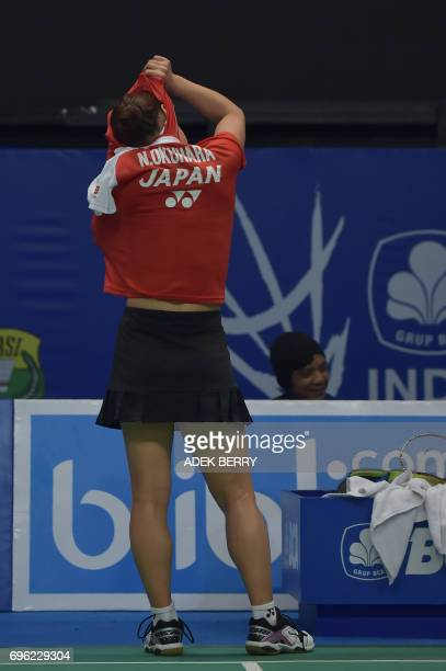Nozomi Okuhara of Japan plays a return against Akane Yamaguchi of Japan during their women's singles badminton Indonesia Open in Jakarta on June 15...