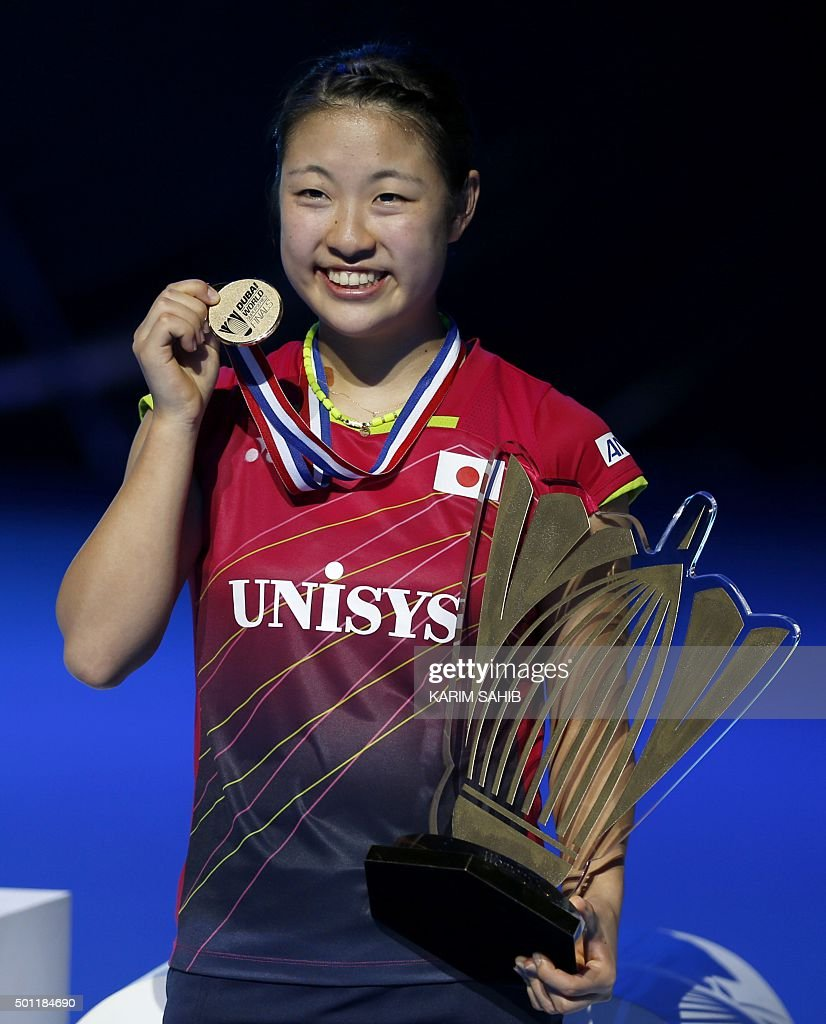 Nozomi Okuhara of Japan poses with her gold medal after winning