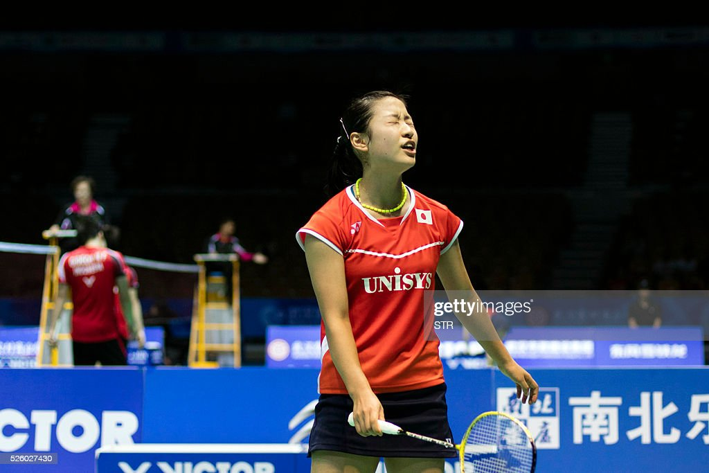 Nozomi Okuhara of Japan reacts during the women's singles quarter-final match against Wang Yihan of China at the 2016 Badminton Asia Championships in Wuhan, central China's Hubei province on April 29, 2016. / AFP / STR