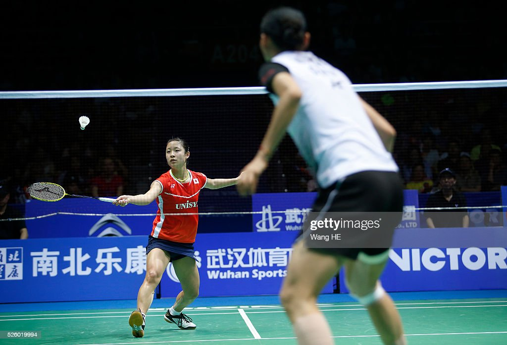 Nozomi Okuhara of Japan returns a shot to Wang Yihan of China during their women's singles match at the 2016 Badminton Asia Championships on April 29, 2016 in Wuhan, Hubei province, China.