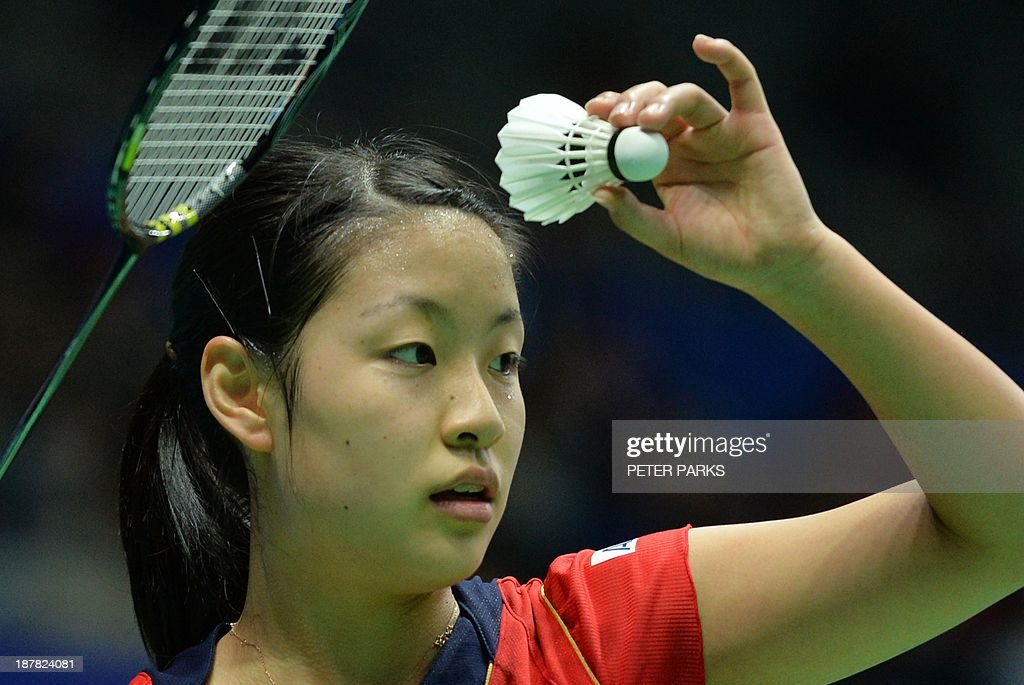 Nozomi Okuhara of Japan serves to Saina Nehwal of India in the women's singles first round at the China Open badminton tournament in Shanghai on November 13, 2013. Nehwal won the match 21-14, 21-19. AFP PHOTO/Peter PARKS