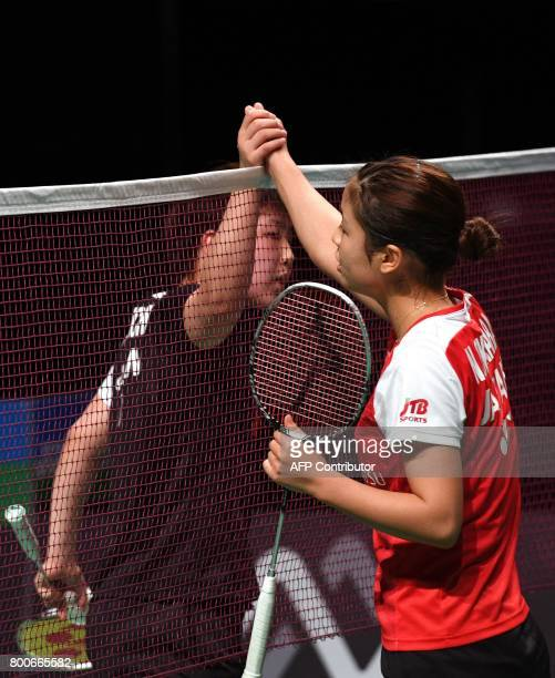 Nozomi Okuhara of Japan shakes hands after defeating compatriot Akane Yamaguchi in the Australian Open women's singles badminton final in Sydney on...
