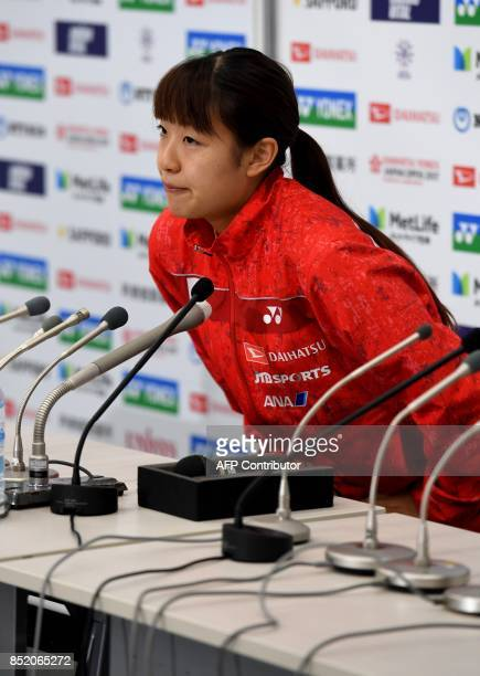 Nozomi Okuhara of Japan sits to hold a press conferene after she decided to withdraw from the women's singles semifinal match against Carolina Marin...