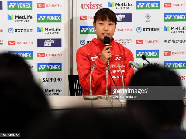 Nozomi Okuhara of Japan speaks during a press conferene after she decided to withdraw from the women's singles semifinal match against Carolina Marin...