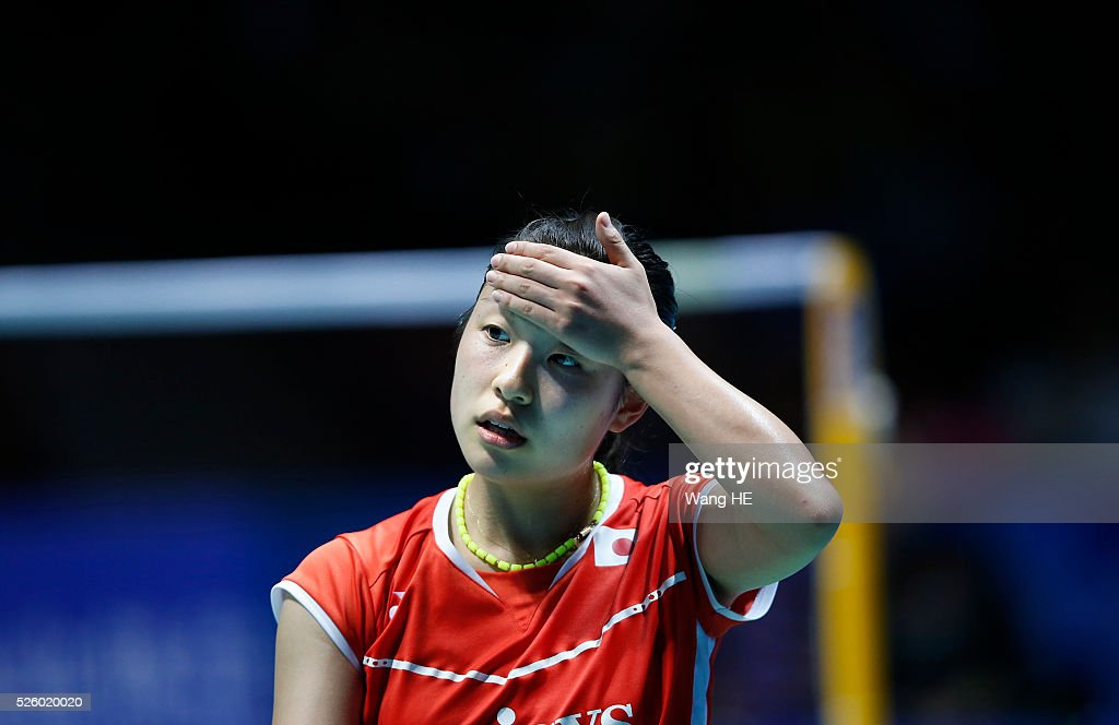 Nozomi Okuhara of Japan wipes sweat from her face during her Women's singles match against Wang Yihan of China at the 2016 Badminton Asia Championships on April 29, 2016 in Wuhan, Hubei province, China.