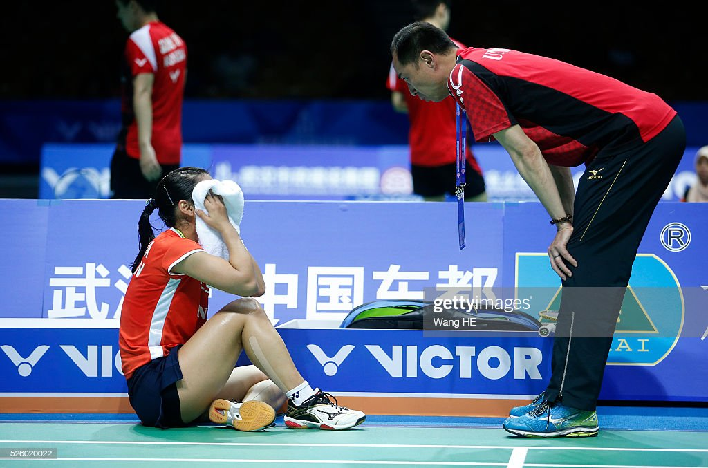 Nozomi Okuhara of Japan wipes sweat from her face during her Women's singles match against Wang Yihan of China at the 2016 Badminton Asia Championships, on April 29, 2016 in Wuhan, Hubei province, China.