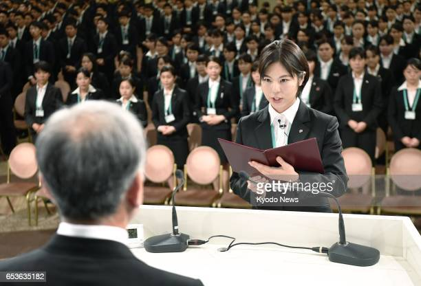 Nozomi Sugita representing new recruits of 22 group companies of retail giant Seven amp i Holdings Co gives a pledge during a welcoming ceremony at a...