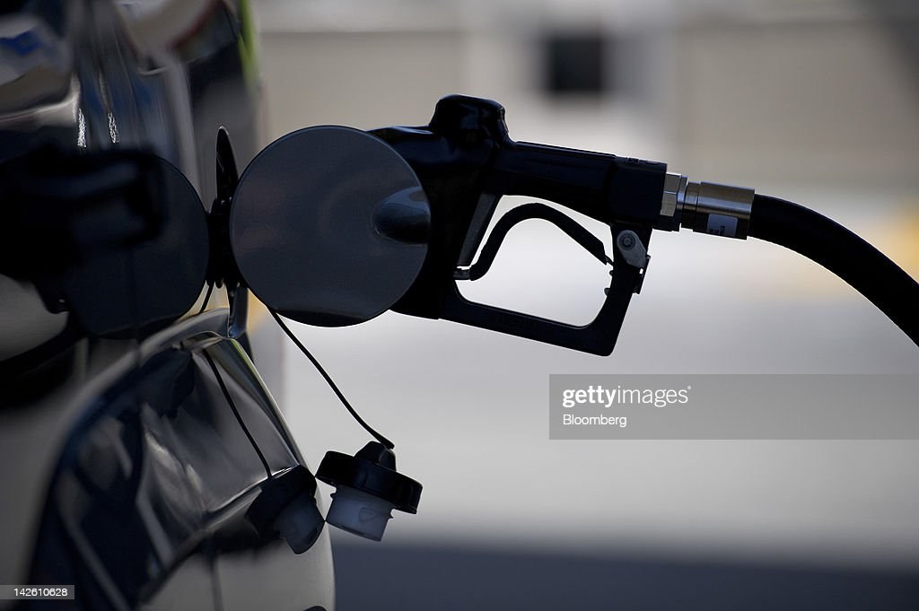 A nozzle pumps fuel into the gas tank of a car at a Chevron Corp. gasoline station in San Francisco, California, U.S., on Friday, April 6, 2012. Gasoline slid to a four-week low as slower job growth in the U.S. and accelerating inflation in China raised concern that global demand for fuel may shrink. Photographer: David Paul Morris/Bloomberg via Getty Images